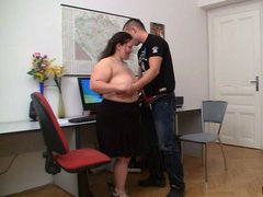 Fat beauty spreds her legs at working place