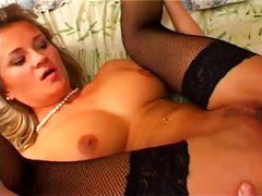 Appetizing blonde in black stockings lets this guy use her holes