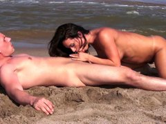 Busty milf squirts on the beach