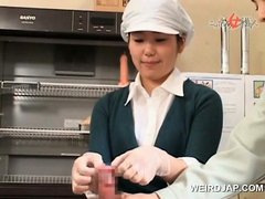 Asian baker girl learns to rub dick and put on a condom