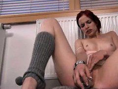 Amazing redhead toying her pussy