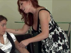 Mature lesbian redhead Brittany O'Connell does her best to seduce