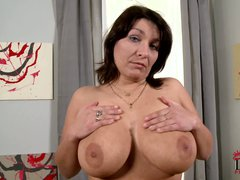 Dark haired Sophia Moroe takes off her white t-shirt and
