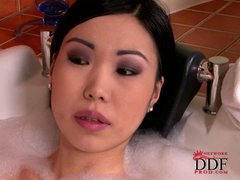 Asian chick Nicoline takes a bubble bath with her fuck