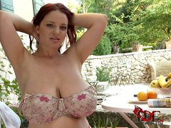 Curvy red=haired babe Joanna Bliss with massively big natural tits