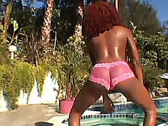 Ebony babe getting an interracial DP