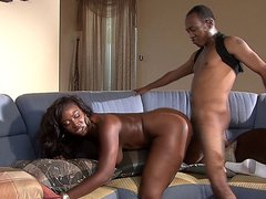 Hot ebony babe taking black dick on the couch