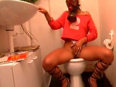 Gas mask wearing Euro German slut masturbates in the toilet