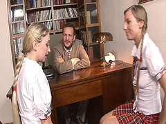 Two naughty schoolgirls getting banged by the dean while having lesbian sex