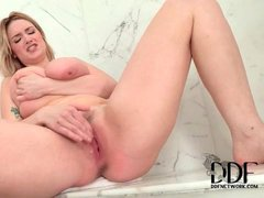 Chubby beauty rubs clit and fingers pussy