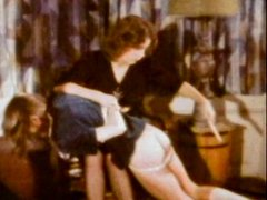Naughty schoolgirl spanked by her teacher in vintage porn scene
