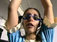 German freak with maid outfit and swimming goggles in bondage scene