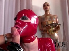 Latex hood on slut sucking big cock