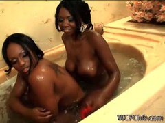 Sexy ebony lesbian duo using toys in the tub