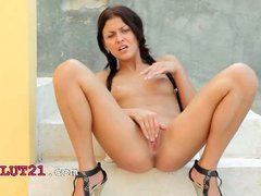 Brunette model in heels rubbing a clit