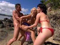Sunny threesome on the beach and in the ocean