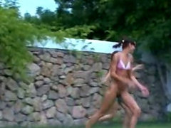 Russian chicks watersports in the grass