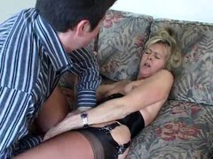 Mature in a hot corset foreplay with her man