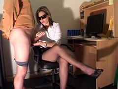 Lovely lady in the office gives a hot handjob