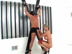 Muscular chick teases man she has in bondage