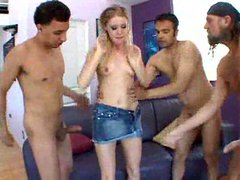 Three guys gangbang a blonde whore