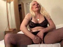 Mature blonde has a toy for her pussy