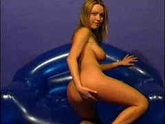 Undressing on blowup couch