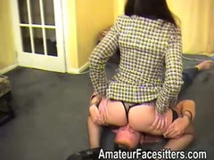 Posh Rose facesits an eager guy in her business suit