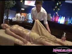 Busty Girl Massaged With Oil Hairy Pussy Fingered By The Masseuse On The Massage Bed