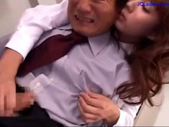 Office Lady Sitting To Her Colleague Jerking His...