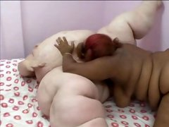 Obese white chick and her fat black gal pal sharing dildos and vibrators in their fat pussies
