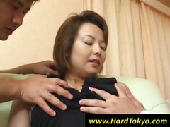 Mature Asian wife gets her luscious boobs groped by two guys