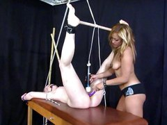 Blonde mistress is fucking her tied up slave with toys and vibrator