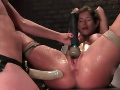 Busty brunette slave is strung up and abused by her blonde mistress