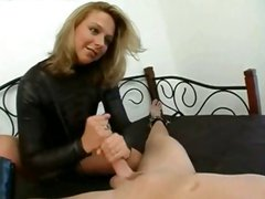 Blonde mistress ties him to the bed and gives a hot stroking handjob