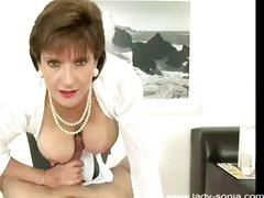 Lady Sonia is a mature brunette with nice round tits for a titty fuck