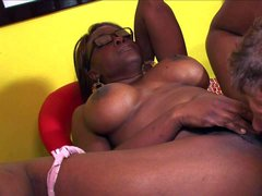 Four-eyed black woman with big tits and juicy ass is