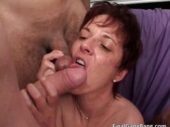 Nasty brunette MILF blows stiff cock part3