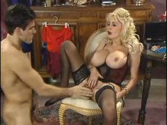 Retro porn scene with blonde in black lingerie