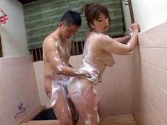 Soapy Japanese girl gives her body