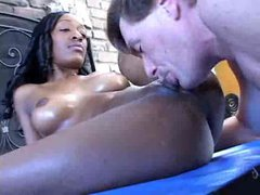 Smooth and slick black chick taking white cock