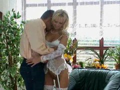Beauty in white lingerie in foreplay